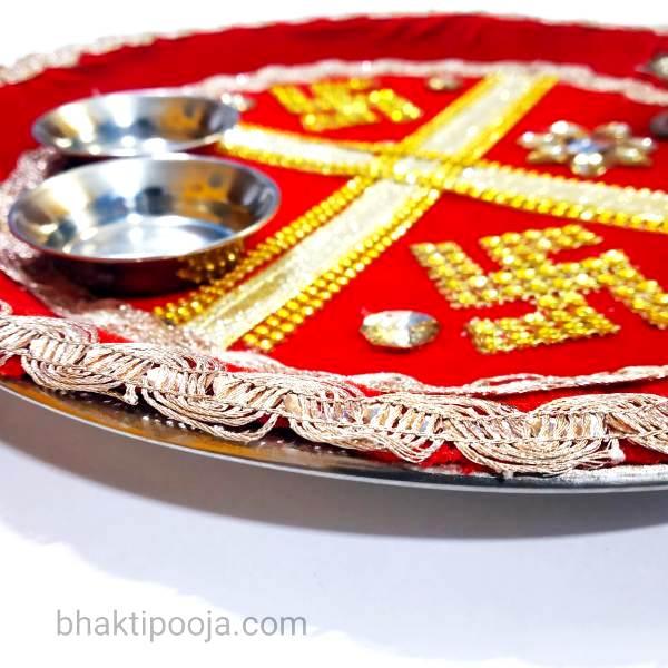 swastik decorated pooja thali